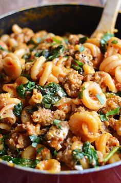 One Pot Roasted Red Pepper and Sausage Alfredo.  Roasted red peppers, Italian sausage, spinach, garlic, and goat cheese