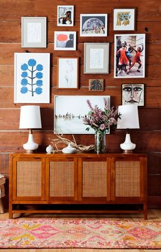 If your space lacks a natural attention-grabber, such as a fireplace or television, create one. Pair a mirror or artwork with a console table, bench, or shelves to create a point of interest on your far wall. #decorideas #upcycledecor #homedecor #wallart #bhg