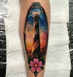 Realistic lighthouse in a traditional rope frame by John Barrett.