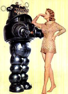 "Promotional art featurnig actess Anne Francis and Robby the Robot from the 1956 movie ""Forbidden Planet""."