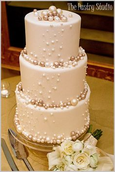 Elegant Wedding Cake with Pearls Photo make the pearls with chocolate covered cheesecake. I love pearls for weddings. So classy and elegant!Source From Pearls Photo make the pearls with chocolate covered the wedding cake. Wedding Cake Pearls, Elegant Wedding Cakes, Beautiful Wedding Cakes, Gorgeous Cakes, Pretty Cakes, Amazing Cakes, Rustic Wedding, Wedding Simple, Cake Wedding