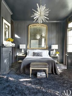 In the guest room of a New Orleans home designed by Lee Ledbetter, the bedside tables are vintage Paul McCobb, and the Louis XVI–style bench is clad in a Pollack velvet | archdigest.com