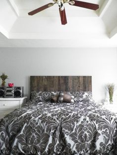 diy wood pallet headboard; I actually think Gare would like the geometric look of this.