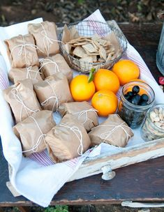 Pack sandwiches in paper and twine...from Heather Bullard