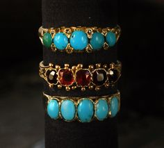 Turquoise and garnet rings  Garnet & turquoise together on a jewelry piece is so cool.