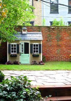 playhouse with little weathervane, working shutters, doorbell, flower boxes under the windows, aprox $500