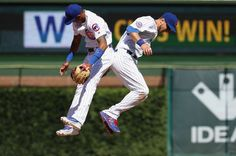 Cubs celebrate:    Addison Russell, left, and Ben Zobrist of the Chicago Cubs celebrate the 3-1 win over the Texas Rangers at Wrigley Field in Chicago on July 16.