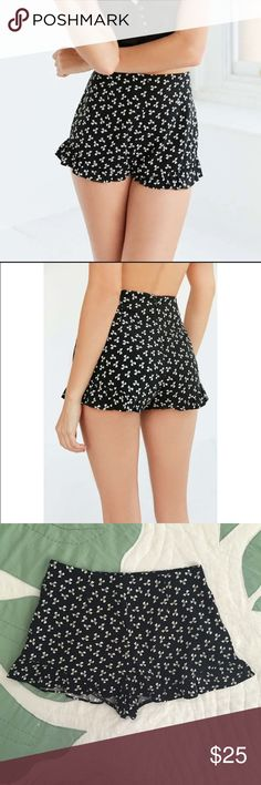 Cooperative Ruffle Print Pinup Short in Black NWOT. Never worn. Very cute Cooperative brand ruffle hem high-waisted shorts with concealed zipper in back. Simple geometric, ribbon-like white print on black fabric. 100% rayon.  Cooperative Shorts