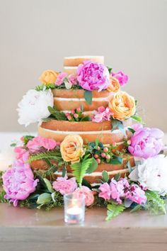 The perfect naked cake with beautiful blooms: http://www.stylemepretty.com/2014/12/05/whimsical-summer-wedding-at-highlands-country-club/   Photography: Cassi Claire - http://www.cassiclaire.com/