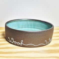 Pottery dog bowl with Slurp and Munch on the outside