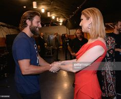 In this handout photo provided by American Broadcasting Companies Inc, actor Bradley Cooper and singer Celine Dion attend Stand Up To Cancer (SU2C), a program of the Entertainment Industry Foundation (EIF), staging its fifth biennial fundraising telecast at the Walt Disney Concert Hall on Friday September 9, 2016 (8:00-9:00 p.m., ET/PT) in Hollywood California.