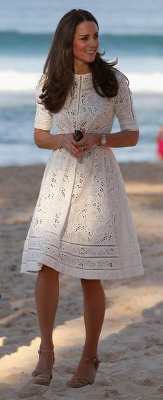 The Duchess at Manly Beach, wearing a white eyelet Zimmermann dress.
