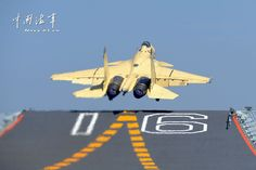 Shenyang J-15 Flying Shark naval-based fighter taking off from aircraft carrier Liaoning, People's Liberation Army Navy (PLAN) - Xinhua.