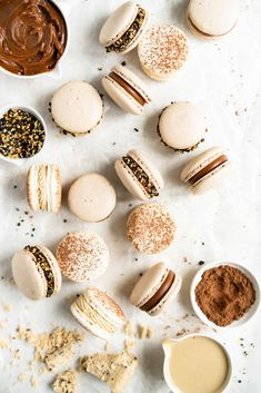 Sesame Macarons Two Ways - Chocolate Macarons with Salted Caramel Tahini Milk Chocolate Ganache and Sesame Brittle, and Vanilla Bean Macarons with Coffee German Buttercream and Halva — Cloudy Kitchen - Chocolade Pastry Recipes, Cookie Recipes, Dessert Recipes, Tahini, Cannoli, Milk Chocolate Ganache, Macarons Chocolate, Chocolate Shells, Macaron Recipe