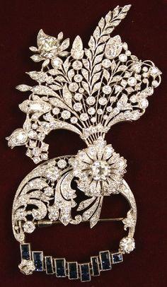 Art Deco diamond, sapphire, and platinum brooch.