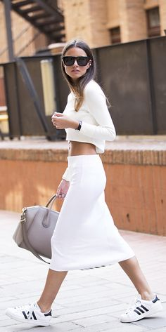 Zina Charkoplia is wearing a top from Lanston, skirt from Jonathan Simkai, bag from Givenchy and the shoes are from Adidas
