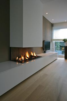 Other Scandinavian living room design ideas might include the balance between an inside and outdoor spaces. Let us show you some Scandinavian living room design ideas for you to get the gist of it and, who knows, find your new living room décor. Home Fireplace, Modern Fireplace, Living Room With Fireplace, Home Living Room, Living Room Designs, Living Room Decor, Inset Fireplace, Fireplace Ideas, Contemporary Fireplace Designs