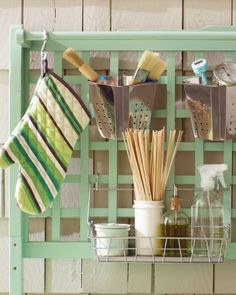 Use metal S hooks to hang anything with a built-in loop (such as oven mitts and pans), as well as bins, racks, and grill baskets.  Corral small tools, such as basting brushes and meat thermometers, in stainless steel perforated bins and wire racks, which resist rust and won't collect rainwater.  See Ikea for accessories