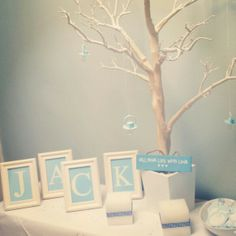 I like the use of the colored letters in white frames. Could always use to spell out Boy, Girl, Baby, or any other shower-themed word. Shower Party, Baby Shower Parties, Shower Gifts, Bridal Shower, Baby Showers, Cadeau Parents, Boy Christening, Baby Shower Games, Baby Games