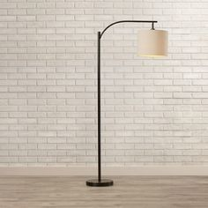 Features:  -3 Way socket for adjustable lighting.  -Oatmeal fabric drum shade gives this item the warmth your room needs.  -Shade included.  Base Finish: -Oil Rubbed Bronze.  Shade Material: -Fabric.