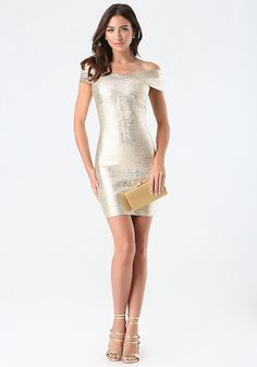 Pop the champagne. Stunning bandage dress with a luxurious brushed gold-metallic foil and breathtaking off-shoulder design. Back hook-and-eye and goldtone zip closure.