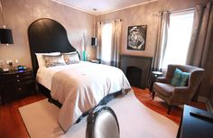 The Leon Russell Room 214--If you're from Oklahoma, you know singer, songwriter Leon Russell. Inducted into the Hall of Fame in March of 2011, Russell began his musical career here in Tulsa, Oklahoma. From the grand piano headboard and area rug, and the hand painted portrait above the fireplace, this awesome room is the place to stay for legendary music fans.