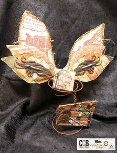 In between Christmas and New Year, we'd like to inspire you with a set of slightly distressed, vintage Wings on Wednesday. Cathy Frailey is here with her slightlysteampunk-ish take on our theme. I love old, rusty things and bought a few old springs for decor and upcycling. So what better way to both upcycle and make a decor piece than Wings of Wednesday?! Tattered Angels and 7gypsies products are perfect for this project - they provide sparkle, whimsyand that vintage factor. - shares Ca...