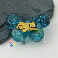 Glass Butterfly Lampwork Bead Shimmering by GlitteringprizeGlass This butterfly shimmers so brightly she looks like she's ready to take off! Set on a cool blue base, inside are sparkling dichroic particles that catch the light. As we move towards the outer wings the blue graduates to darker shades, the centre is decorated with gold leaf and a fine black detail. A bead to used in a special piece of jewellery to treasure. #glitteringprizeglass #lampwork #butterfly #dichroic #gold #blue #focal