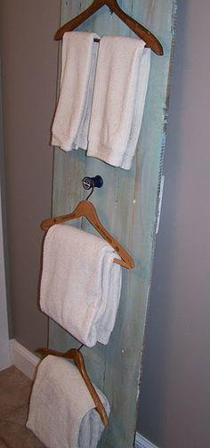 Bathroom towel rack from wood hangers and old door