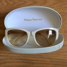 Vivienne Westwood sunglasses A pair of white, cat eye-ish sunglasses by Vivienne Westwood. They are white with gold accents win a blush lens. The inside of the glasses are also a blush shade. Designs tire logo on the side. Case is a little scuffed but glasses are in great condition. Literally worn 4-5 times. Vivienne Westwood Accessories Sunglasses