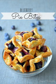 """Blueberry Pie Bites - Little bites of delicious pie crust, each stuffed with a fresh blueberry and a little raw sugar. Blueberry Pie Bites are great when you want """"just a bite""""! They also make excellent ice cream topping! Just Desserts, Delicious Desserts, Yummy Food, Pie Dessert, Dessert Recipes, Dinner Dessert, Recipes Dinner, Drink Recipes, Tapas"""