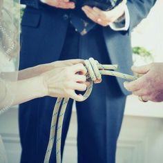 "Couple ""tying the knot"" They tied a fisherman's knot during their ceremony. This is the strongest knot, in fact, the rope will break before the knot comes undone. The knot can be framed in a shadow box with a picture from the ceremony as a keepsake. Unity Ceremony, Wedding Ceremony, Our Wedding, Dream Wedding, Trendy Wedding, Wedding Knot, Wedding Stuff, Wedding Photos, Ceremony Seating"