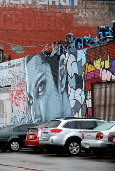 Her eyes like emotion sensors,  a collaborative piece by Christina Angelina, Ease, and Sek & Mar 2014. LA Arts District. Downtown Los Angeles, California Zippertravel.com Digital Edition
