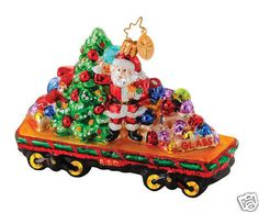 Deck the Rails Christmas Ornament Christopher Radko 1014642 B & O Railroad Collection - Retired Deck the Rails is an open train car loaded with a Santa with a Christmas tree, toys and Hand Painted Ornaments, Santa Ornaments, Vintage Christmas Ornaments, Glass Ornaments, Train Ornament, Christopher Radko Ornaments, Christmas Train, Trendy Tree, Holidays And Events