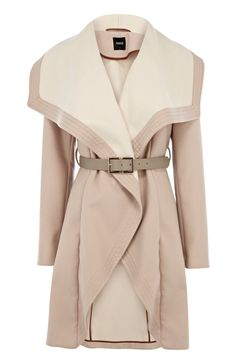 This gorgeous tonal drape coat features a colour block effect across the fabric with a slightly paler inner lining for a high fashion, luxurious finish. The piece features a waterfall open front with a wide waist belt 98with metallic buckle fastening to nip you in at your waist for a feminine finish. 98