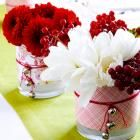 Floral fun Enliven basic glass vases with Christmas-color scrapbooking papers. Simply cut papers to fit around the vases and secure with double-sided tape. Tie red string (with silver bells attached) around the vases and insert winter bouquets. Change the colors for anytime of year.