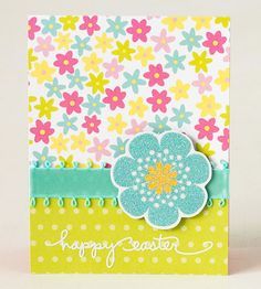 Layer patterned paper, playful ribbon, and a glittery flower to make this delightful Easter card. Use a sticker or your best handwriting to leave the recipient an Easter note.  Editor's Tip: For even more sparkle, use shiny flower stickers on a white background instead of patterned paper