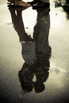 Kissing couple reflection