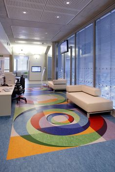 UCLH Macmillan cancer centre waiting area floor designed by Pure Evil created into sonic cut floor tiles by Floorcraft