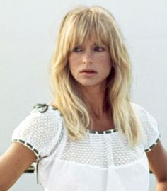 Goldie Hawn's shaggy bangs of 1992 blend into the rest of her style, framing her ageless—she's 47 here!—