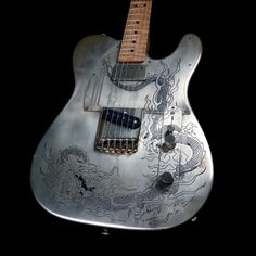 james trussart tele: steelcaster. dragon engraved.