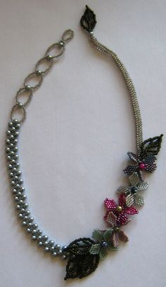 Asymmetrical necklace.  Glass pearls, Japanese Delicas and seed beads.