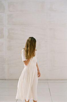 simple, ageless dress. wavy natural hair.
