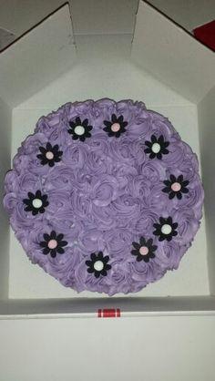 Swirling of white and dark mudcake with strawberry vanilla buttercream roses