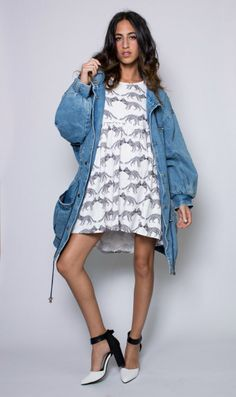 An oversized 80s vintage denim jacket that won't give you the blues. This light wash denim jacket hosts an array of heavy metal accents, along with a synched drawstring waist, a wide collar, and warm cotton lining throughout. Wear it over your favorite smock dress or romper to complete the look.