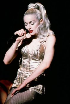 Madonna performs Like a Virgin at her Blond Ambition tour in 1990.