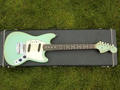 Vintage Surf Green Fender Mustang.  MY DREAM GUITAR!! :D