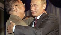Russian President Vladimir Putin (right) greets North Korean leader Kim Jong-il during their meeting in Vladivostok, Russia, on Aug. 23, 2002. (AP Photo/Alexander Zemlianichenko, File)