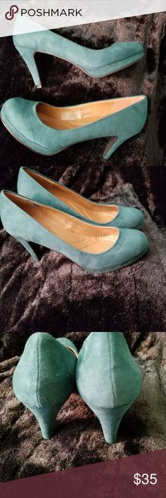 Dark green suede like platform pumps or heels Dark green suede look platform heels or pumps in 7W by Boston Design. Never worn, still in plastic. Color is a little darker than in photo. Great for fall dressing. boston design Shoes Platforms