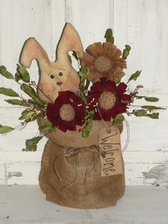 http://woodrufflesandlace.com/ Primitive Bunny and Flower arrangement with Burlap Pouch...Tan Burgundy Flowers